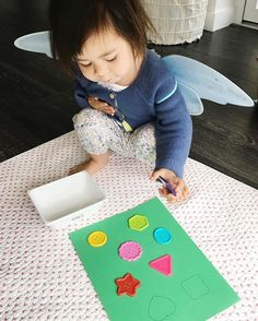Shape matching activity - she practiced colours and shapes, great for fine motor skills.