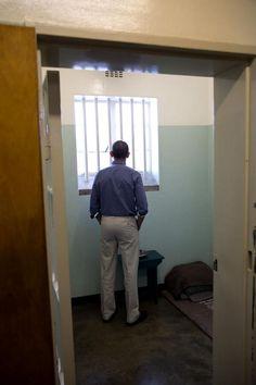 Pres Obama in Nelson Mandela's prison cell on Robben Island: pete souza