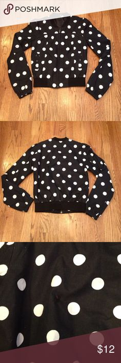 Black/White Jacket Black & White polk a dot jacket. Light weight, w/ zipper & pockets in front. Gathered at the  shoulders. Elastic band at waist & arms. Divided by H&M. Size 6. In great used condition. One minor flaw on back of jacket. Perfect wind breaker. H&M Jackets & Coats