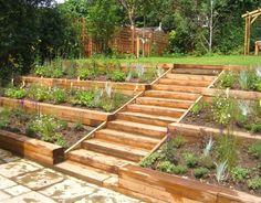 Garden On A Slope This Terraced Garden Designed By Garden Design Made Use Of Natural Slopes Diy Garden Steps Slope