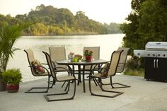 This durable patio set looks great with or without an umbrella.