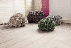 Cones is a series of poufs by Jule Waibel, a German designer now based in London.A continuation of Waibel's interest in pleated fabric, the collection plays upon the idea of unfolding a stone. Decor Interior Design, Furniture Design, Folding Structure, Contemporary Design, Modern Design, Origami, Leather Stool, Take A Seat, Furniture Inspiration