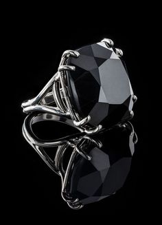 Cushion cut 34 carat black onyx cocktail ring. Sterling silver basket holds a hand prong set dark onyx gemstone. A Darby Scott exclusive design. Black Onyx - Sterling Silver If your size is not in sto