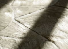 COWHIDE PATCHWORK RUG  Materials: Argentinian Cowhide Characteristics: Tough, sophisticated and resilient  Options: Custom dyed colors / Size / Hide / Borders / Backing / Stitching
