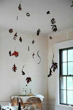 Autumn leaves hanging from the ceiling by fine threads...
