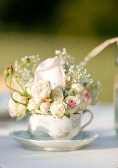 use tea cups from bride and grooms mother, grandmothers etc as part of the centre piece