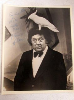 Comedian Marty Allen with contemplating Cockatoo ('cause that hair DOES look like a nest!)