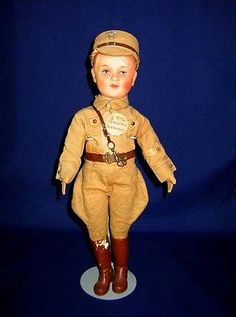 """Antique-German-Nazi-Doll-Breslau-All-Original. Sold Feb. 2015 for $243.50. -- German Nazi Doll Breslau  This dollmeasures approximately 13"""" tall to the top of his hat, and hewears his original uniform and tag. The clothing is sewn on and the cap attached, therefore it is difficult to fully view the markings on the lower back of his neck, but it looks like KM. Ibelieve this is a painted bisque head, although I cannot confirm this without removing the clothing, which I prefer not to do. He…"""