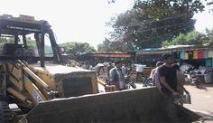 Encroachments cleared around Gandhipuram.