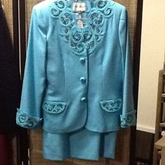 """Nolan Miller Mother of the Bride/Groom, teal blue Nolan Miller, 2 pc. teal blue lined suit. Perfect for Mother of the Bride/Groom. Beautiful beading on pockets of jacket, cuffs and neckline. Buttons are actually snaps. Size 12, skirt measures approx 27"""" long, waist measures, 31"""" buttons and zippers in back. Excellent condition, looks brand new. Nolan Miller Dresses"""