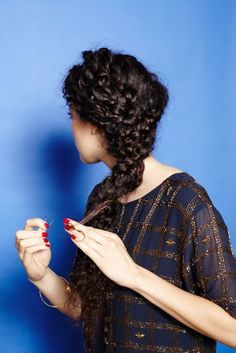 Despite the easy volume and natural va-va-voom drama, curly-haired girls often complain that they're left out when it comes to styling ideas. And, while stuffing curls into a bun or choke-holding them into a tight braid is a no-brainer, there are some...