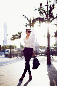 Shop this look on Lookastic: http://lookastic.com/women/looks/sunglasses-skinny-pants-pumps-dress-shirt-tote-bag/5011 — Black Sunglasses — Black Leather Skinny Pants — Black Leather Pumps — White Dress Shirt — Black Leather Tote Bag
