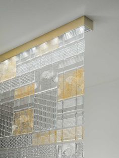The D95 Tile ceiling lights designed by Pamio Design, contains individual tiles that are handmade by the artisans using molten glass. The fixture is available in various finishes - polished aluminum or golden aluminum. See more handmade glass lights at LightForm.ca