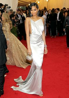 Chanel Iman in grey backless gown with pleat detail by Topshop with Lorraine Schwartz jewelry.