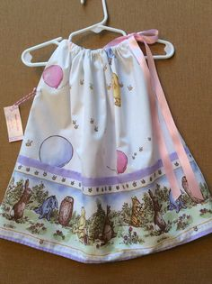 This Winnie the Pooh dress is made from vintage sheet material. It is a cotton poly percale blend. This is a made to order dress in sizes 6 mo to