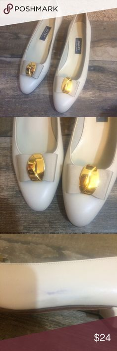 Bailey Cream & Gold Pumps w/ small heel Size 8 Made in Switzerland  Very gently worn Hardly any wear on bottom  Scuff mark that may come out on side see pic 3. Small wedge heel. Gold design top Bailey Shoes