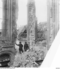 Australian soldiers inspecting the smashed altar in the ruined church of Bapaume in March 1917