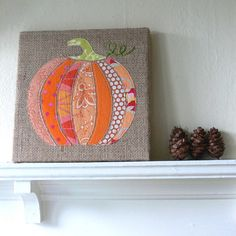 burlap pumpkin art - you can buy the kit for $10...  But I could do this!!  Super cute!