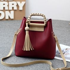 Luxury tassel leather composite handbag