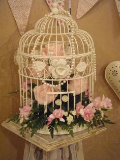 Flowers in birdcage for ceremony backdrop