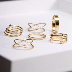 Adorn your fingers with this set of rings. The set includes 6 gold rings that you can wear separately or stack.