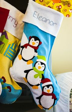 diy felt stocking with embroidered name and felt applique penguin design
