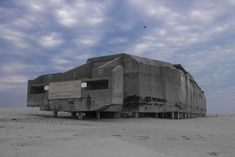 Dead giant on the beach : Abandoned Cape May concrete WW2 bunker, New Jersey, USA