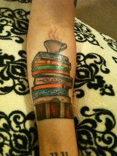 Stack of books and cup of tea tattoo.