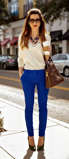 Colorful office outfit idea! Tile blue double weave ankle columnist pants with elegant ivory blouse blouse, green pumps, chestnut Tory Burch satchel, and jewel-toned statement necklace | Wear Blue Like It's Black: Ivory Lace + Tile Blue Columnist Work Outfit