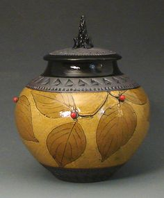 http://www.artfulhome.com/product/Ceramic-Vessel/Small-Amber-Jar-with-Red-Berries/80818