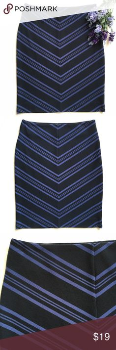 """{Halogen} Asymmetrical Striped Pencil Skirt Comfortable pencil skirt. Asymmetrical stripe pattern. Side zipper with hook and eye closure. Color: Deep navy and purple/blue. 14 1/2"""" flat across waist. 21 1/2"""" long. 66% polyester 33% rayon 1% spandex. Good preloved condition. Halogen Skirts Pencil"""