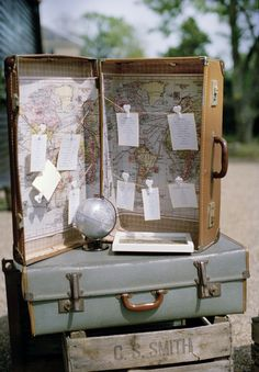 vintage suitcase with a map inside & favourite place table plan