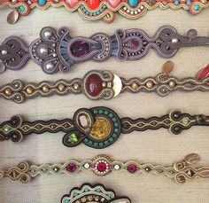 a whole lot of trendy Dori bracelets.as seen at our Tel Aviv flagship store Soutache Bracelet, Soutache Pendant, Soutache Jewelry, Beaded Jewelry, Trendy Bracelets, Handmade Bracelets, Handmade Jewelry, Soutache Tutorial, Bracelet Crafts