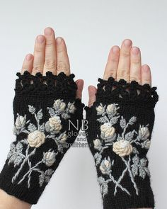 Hand Knitted Fingerless Gloves, Gloves & Mittens, Gift Ideas, For Her, Winter Accessories,Black, Ivory, Flowers, Elegant, Roses, Stumpwork Embroidery, Hand Crocheted Lace, Cozy, Handmade Accessories, For Women, Women  These unique hand knitted accessory can be a wonderful accent to Your clothes :)  Gloves are: length: 18 cm (7,25 inches); circumference of the wrist: 18 cm (7). fiber composition: 60% wool, 40% acrylic; colors: black ground, ivory rose with white center, grey leaves  This is…