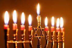 The menorah or nine-branched candelabrum, which is lit during the Jewish festival of Hanukkah. At the centre is the Star of David, a symbol associated with the Jewish faith. What Is Hanukkah, Feliz Hanukkah, How To Celebrate Hanukkah, Happy Hanukkah, Hannukah, Christmas Hanukkah, Kwanzaa, Jewish Menorah, Hanukkah Menorah