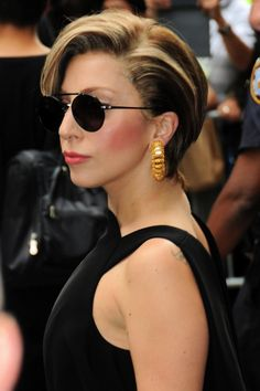 Lady Gaga! Wouldn't even recognize her if it weren't for her signature round black sunglasses!