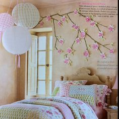 We have neutral walls in the 2nd bedroom, so I'm looking for ways to decorate with accents.  Love the laterns and tree wall art. From PotteryBarn Kids