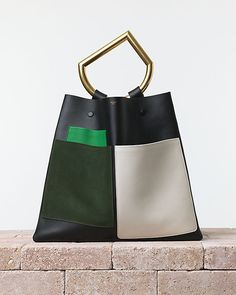 beautiful color block CÉLINE | Summer 2014 Leather goods and Handbags collection. eometrical handbag(one handle) with pockets. In calfskin black