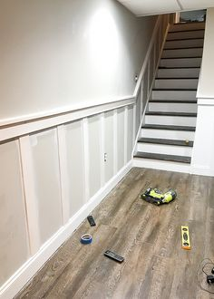 board and batten wall Do It Yourself: How to update and transform a basic basement staircase with board and batten. Basement Staircase, Basement Walls, Basement Bedrooms, Basement Bathroom, Basement Ideas, Basement Inspiration, Basement House, Basement Kitchen, Basement Apartment