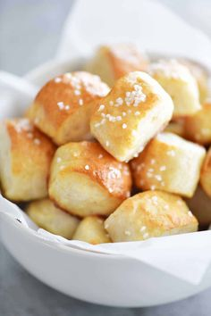 Two Ingredient Dough Pretzel Bites are EASY to make. No yeast and no waiting for dough to rise. Just mix dough, cut, dip in baking soda water and bake!