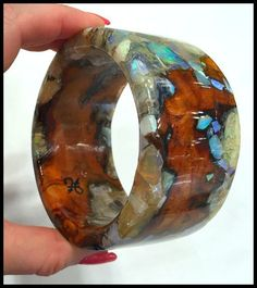A one of a kind wood and gemstone bangle by Freestone Peach Designs. This piece features peach wood with opals.