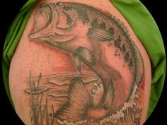 Big Fish Tattoo Showing Bass    The big bass tattoo in delicate and artistic shades reveals the fascination of angling. The basses are generally prized fishes to catch.