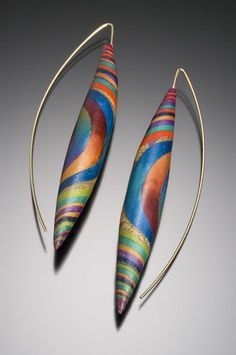 Polymer clay earrings by Kathleen Dustin makes me want to play with clay again soon...