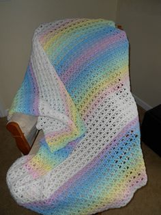 2 Strands held together throughout for rainbow shading. Beautiful crochet baby blanket using size K hook and Lion Brand babysoft yarn in 6 pastel shades and white.