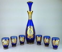 Vintage Murano cordial decanter and shot glass set in cobalt blue and gilt gold with raised enamel flowers. I'm absolutely in LOVE with this set! Head on over to see more photos at my eBay store!