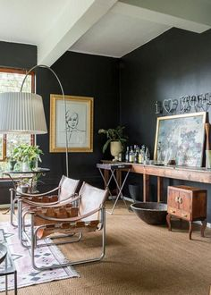 Very cool eclectic home decor. Leather. Lights. Black. Cognac. Wood. Brass