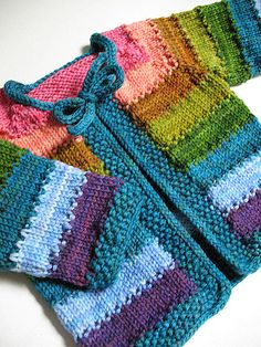 Cute rainbow-striped knit baby sweater