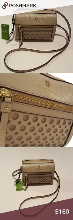 """Kate Spade LooLoo Perri Lane Bubbles Beige Bag NWT Brand new with tags Kate Spade LooLoo Perri Lane Bubbles crossbody bag  Color/Pattern: Clocktower beige pebble leather; lined with beige signature print fabric interior; gold tone hardware; bubbles pattern and gold printed signature on front exterior Zippered top closure; 1 front exterior zippered pocket; leather zipper pulls 1 interior slip pocket Single shoulder/cross-body strap with approx. 19"""" drop Approx. 6.75"""" L x 5.5"""" H x 4"""" W…"""
