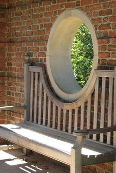 Circle window and bench.