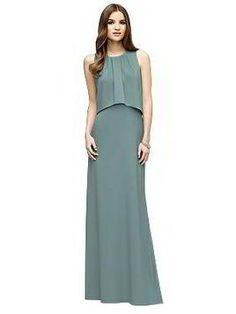 Full length sleeveless crepe dress has overlay bodice. Pleated detail at  jewel neckline. Slightly